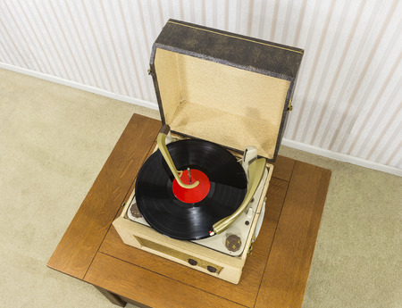 record player: Old record player with vintage vinyl disk.