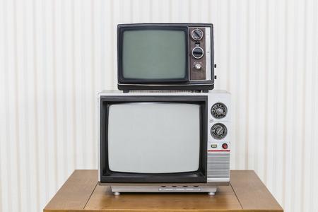 Vintage television stack on old wood table. 版權商用圖片 - 44353221
