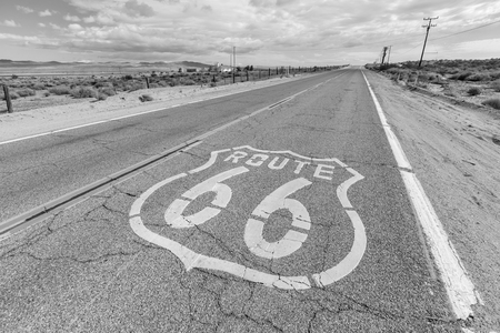 road surface: Old Route 66 desert pavement sign in black and white Stock Photo