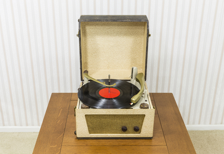 phonograph: Vintage turntable with red record album.
