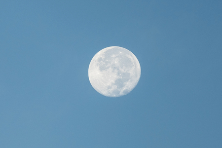 waning moon: Early morning moon with clear blue sky. Stock Photo