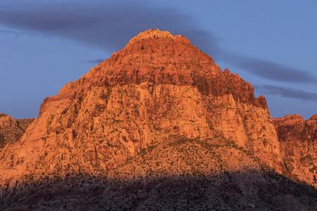 red rock national conservation area: Dawn glow on Rainbow Peak at Red Rock National Conservation Area near Las Vegas, Nevada.