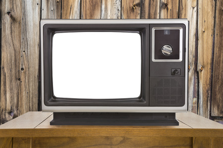 electronic 80s: Old portable television with cut out screen and rustic wood wall.