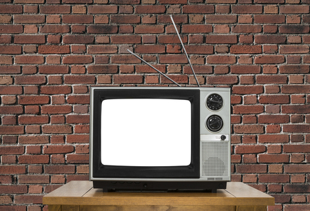 analogue: Old analogue television with cut out screen and brick wall.