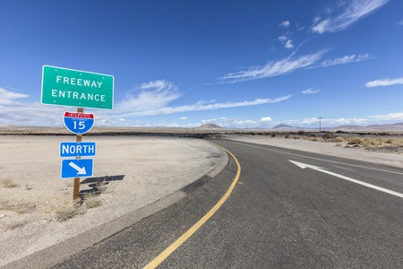 interstate: Interstate 15 desert freeway entrance in Californias Mojave National Preserve. Stock Photo