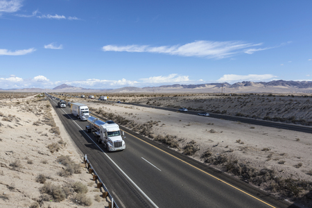 barstow: Mojave Desert, California, USA - October 6, 2015:  Constant truck and tourist traffic in Interstate 15 between Los Angeles and Los Vegas in Californias Mojave Desert.