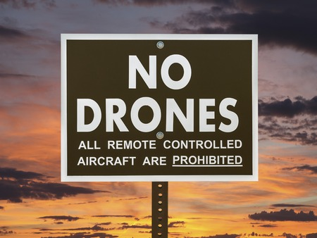 drones: No drones sign with sunset sky. Stock Photo