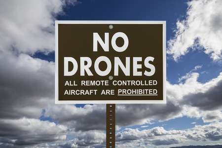 drones: No drones sign with gathering storm clouds