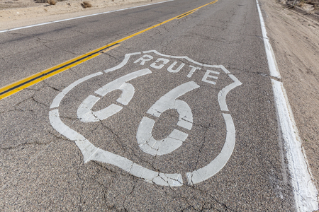 barstow: Old Route 66 sign on broken pavement.