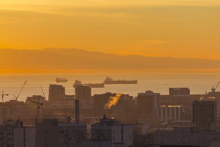 san francisco bay: Warm dawn light on the urban San Francisco bay waterfront. Stock Photo