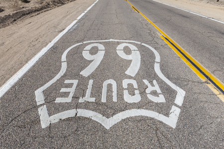 barstow: Upside down view of old Route 66 pavement sign in the Mojave desert.