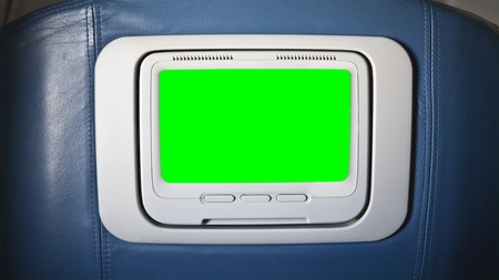green screen: Seat back airplane television chroma key green screen.  Sized to video 4K 4096 x 2304 dimension. Stock Photo