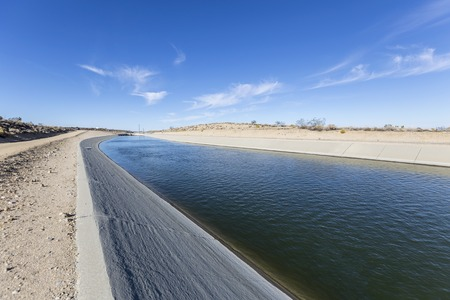 California aqueduct flowing through the Mojave desert in northern Los Angeles County. Фото со стока
