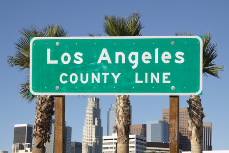 los angeles county: Los Angeles county line sign with downtown Los Angeles skyline in background.