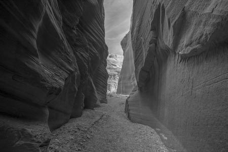 paria canyon: Buckskin Gorge slot canyon in southern Utah in black and white.