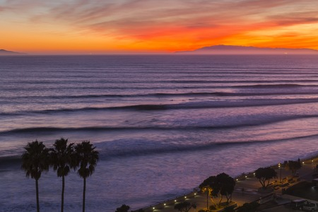 Sunset surf sets rolling in to the Ventura California coast. Stock Photo