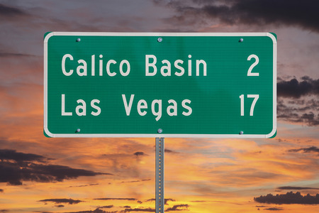 mojave: Las Vegas highway sign with sunset sky.