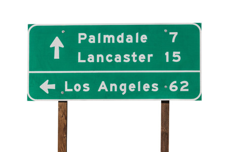highway signs: Palmdale, Lancaster and Los Angeles highway sign isolated on white. Stock Photo