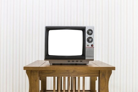 old fashioned tv: Old portable television with antenna on wood table with cut out screen