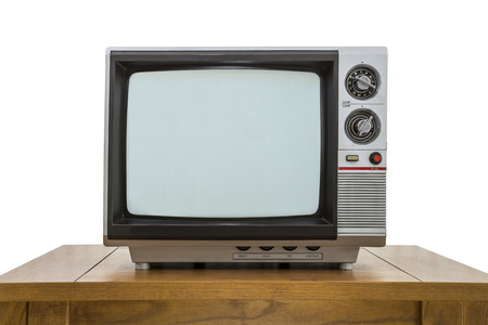 electronic 80s: Vintage portable television and old wood table isolated on white