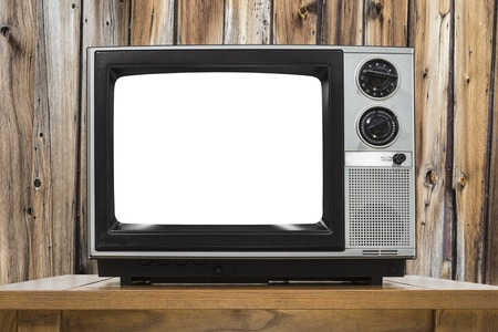 to cut out: Analog television with cut out screen and rustic wood wall.
