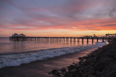 pier: Malibu pier pacific ocean sunset on the Southern California coast.