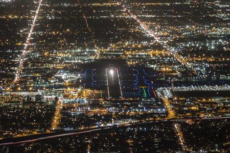 landing light: Night aerial of airport runway in Burbank, California. Stock Photo