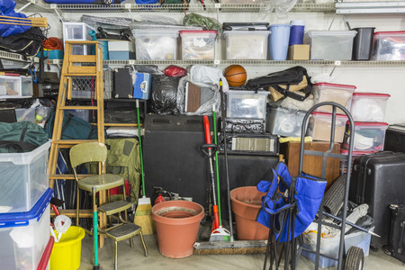 Garage filled with various home storage items.