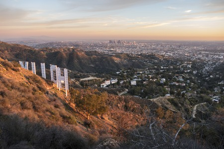 hollywood hills: Los Angeles, California, USA - February 4, 2016:  Hollywood sign and downtown Los Angeles dusk cityscape view.