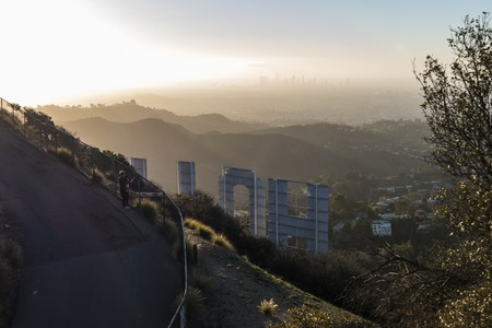 griffith: Los Angeles, California, USA - January 24, 2016:  Hazy Hollywood morning behind the famous Hollywood Sign in Los Angeless Griffith Park. Editorial