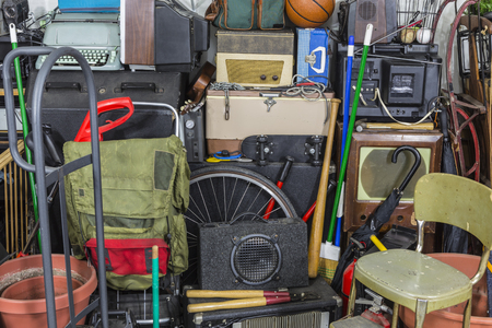junks: Vintage rummage junk pile storage area mess. Stock Photo