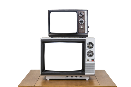 vintage television: Vintage television stack on old wood table isolated on white with cut out screens. Stock Photo