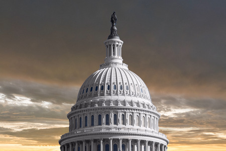 us capitol: US Capitol dome with stormy sunset sky. Stock Photo