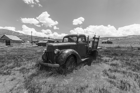 mammoth lakes: Bodie, California, USA - July 6, 2015:  Abandoned pickup truck in black and white at Bodie State Historic Park near Mammoth Lakes, California.