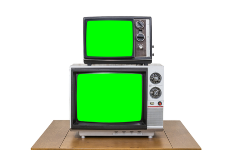 vintage television: Vintage television stack on old wood table isolated on white with chroma key green screens.