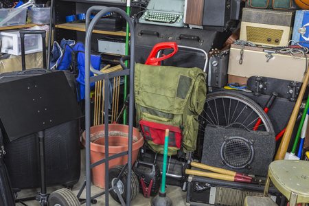 Junk filled corner of storage garage. Stock Photo