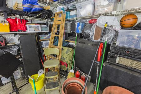 storage: Storage corner in cluttered suburban garage.