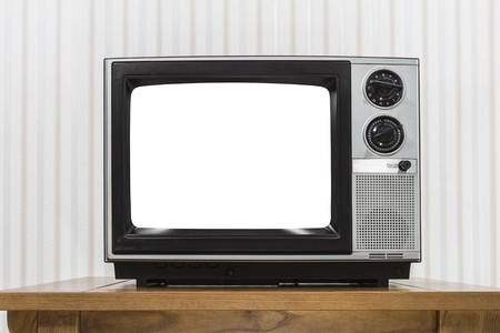 television set: Old portable television set on vintage wood table with cut out screen. Stock Photo