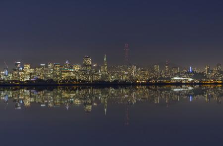 san francisco bay: San Francisco Bay night cityscape skyline with refection.