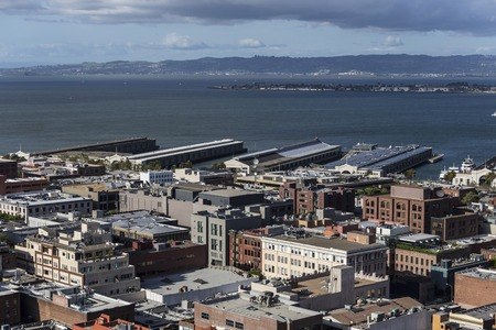 oakland: San Francisco bay waterfront piers with view towards Oakland. Stock Photo