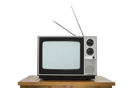 electronic 80s: Vintage television on wood table isolated on white.