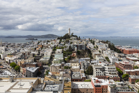 coit: San Francisco, California, USA - April 23, 2016:  Growing clouds over San Francisco Bay, Coit Tower and the North Beach Neighborhood. Editorial