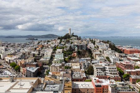 coit tower: San Francisco, California, USA - April 23, 2016:  Growing clouds over San Francisco Bay, Coit Tower and the North Beach Neighborhood. Editorial