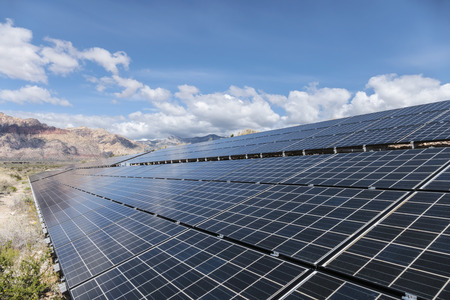 areas: Solar panels with Mojave desert background at Red Rock Canyon National Conservation Area near Las Vegas, Nevada.
