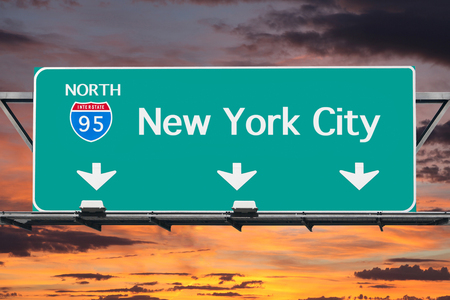 street sign: Interstate 95 to New York City highway sign with sunrise sky.