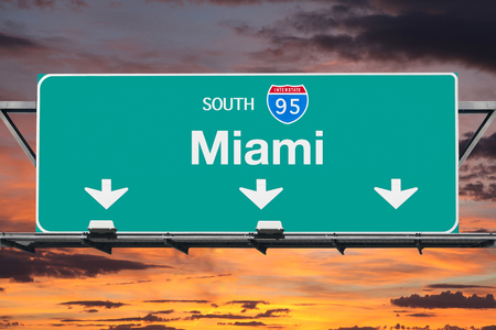 95: Interstate 95 south to Miami highway sign with sunrise sky.