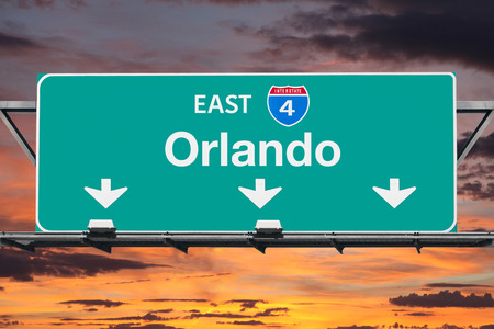 interstate: Interstate 4 east to Orlando highway sign with sunrise sky.