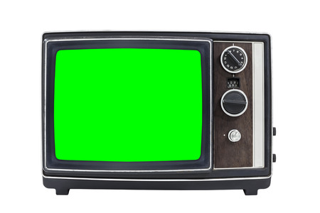 green screen: Small vintage portable television with chroma green screen.