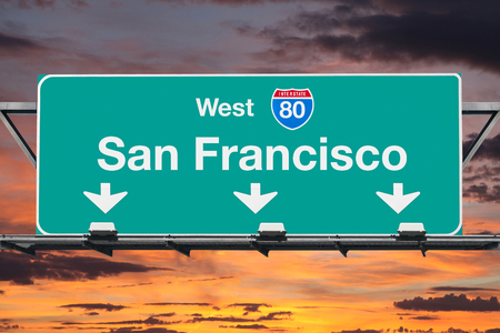 San Francisco Interstate 80 west highway sign with sunrise sky.