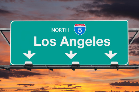 interstate: Los Angeles Interstate 5 north highway sign with sunrise sky.